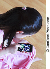 Little girl drawing touch screen ph