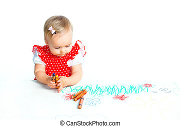 little girl drawing with crayons