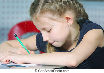 Little girl drawing with pencil