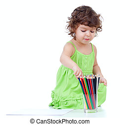 Little girl drawing with  pencils