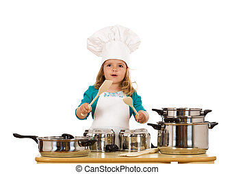 Little girl dressed as a chef having fun