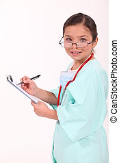 Little girl dressed as a doctor