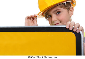 little girl dressed as a security road worker