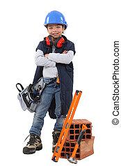 Little girl dressed as builder