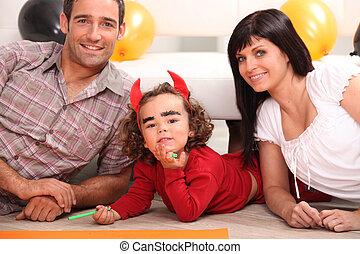Little girl dressed as devil