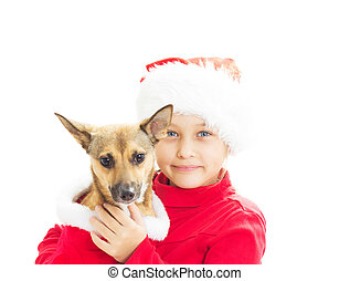 little girl dressed as Santa holds a the redhead dog on white ba