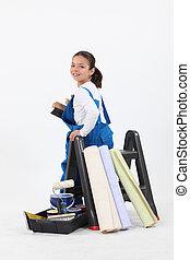 little girl dressed in house painter