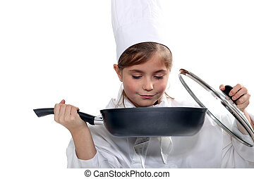 Little girl dressed like a cook on white background