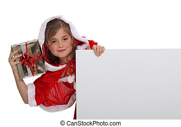 Little girl dressed with Christmas clothing