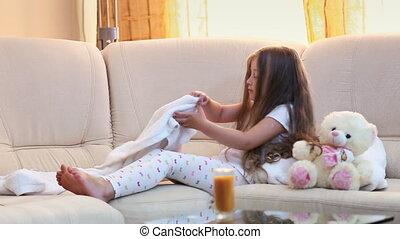 Little girl drinks juice
