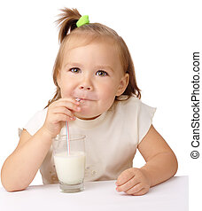 Little girl drinks milk using drinking straw - Cute little...