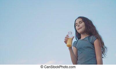 little girl drinks with plastic bottles slow motion video....