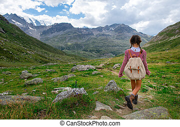 Little girl during a summer camp for kids in the mountains