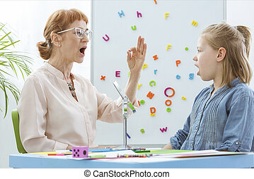 Little girl during speech therapy
