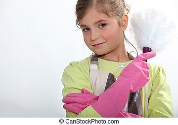 Little girl dusting
