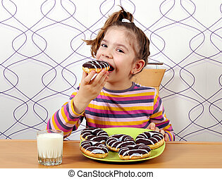 little girl eat chocolate donuts