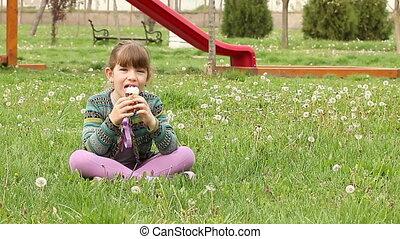 little girl eat ice cream