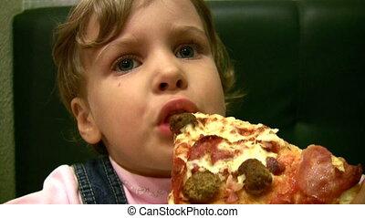 little girl eat pizza