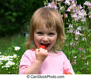 Little girl eat the strawberry