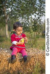 Little girl eating a pear