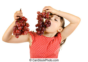 little girl eating bunch of grapes, on white background,...