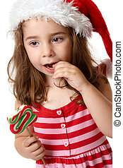 Little girl eating candy - Young little girl eating a...