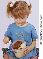 little girl eating chocolate cream