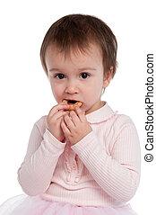 Little girl eating cookies