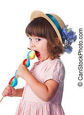 little girl eating lollypop