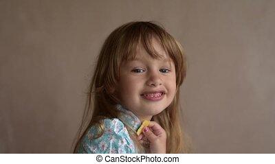Little girl eating potato crisps