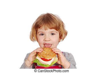 little girl eating sandwich