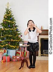 Little girl eating santa cookies