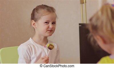 Little Girl Eating Sour