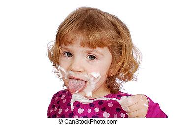 little girl eating sweet cream
