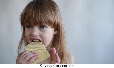 Little girl eating waffle