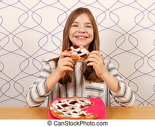 little girl eats a pie with cherries