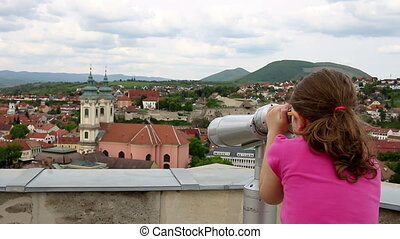little girl Eger Hungary - little girl looking through...