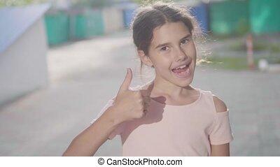 little girl emotion shows gesture yes slow motion video hand...