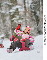 Little girl enjoying a sleigh ride