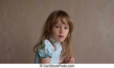 Little girl enjoying crisps
