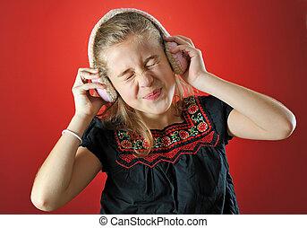 little girl enjoying music