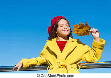 Little girl excited about autumn season. Autumn warm season pleasant moments. Kid girl smiling face hold leaves sky background. Child with autumn maple leaves walk. Autumn coziness is just around