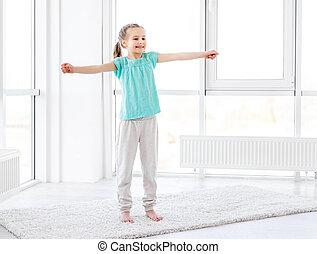 Little girl exercising in gym