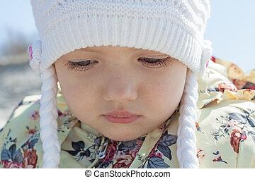 little girl face close up outdoor