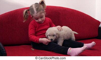 little girl feed pet dog