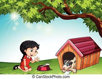 Little girl feeding a pet dog