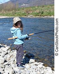 little girl fishing on the river