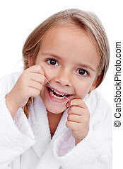 Little girl flossing - Closeup of little girl flossing her...