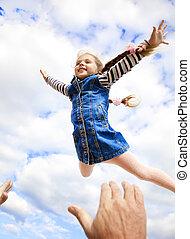 Little girl fly in the sky
