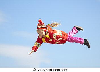 Little girl fly in the sky.